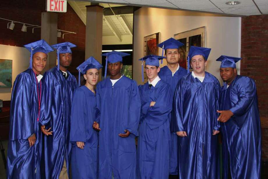Nigel Lara, Dondre Johnson, Juan Baez, Wil Robinson, Brandon Casavecchia, Manny Escalante, Jameson Whiteley and Herbert Rawls pose for a photo before the Briggs High School graduation ceremony begins Monday. Photo: Photos By Kristen Riolo, Contributed Photo / Norwalk Citizen