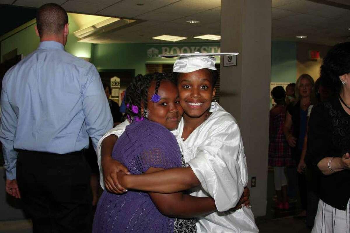 Member of Briggs' Class of 2011 Shaqouia Crenshaw gives her sister Daneesha a hug.