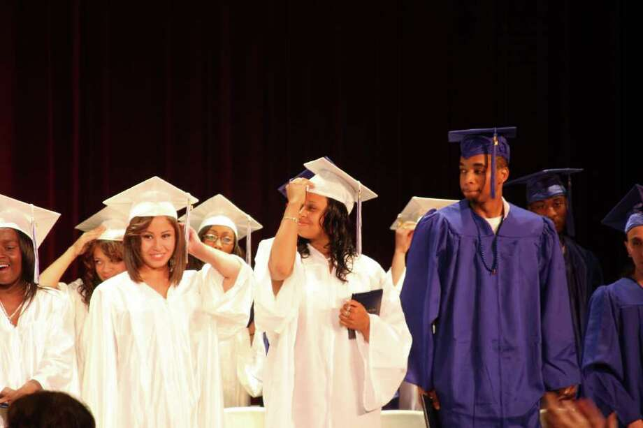 Jessica Cardenas, Afifah Bullock and Brian Bennett, members of the Briggs' Class of 2011, move their tassels. Photo: Photos By Kristen Riolo, Contributed Photo / Norwalk Citizen