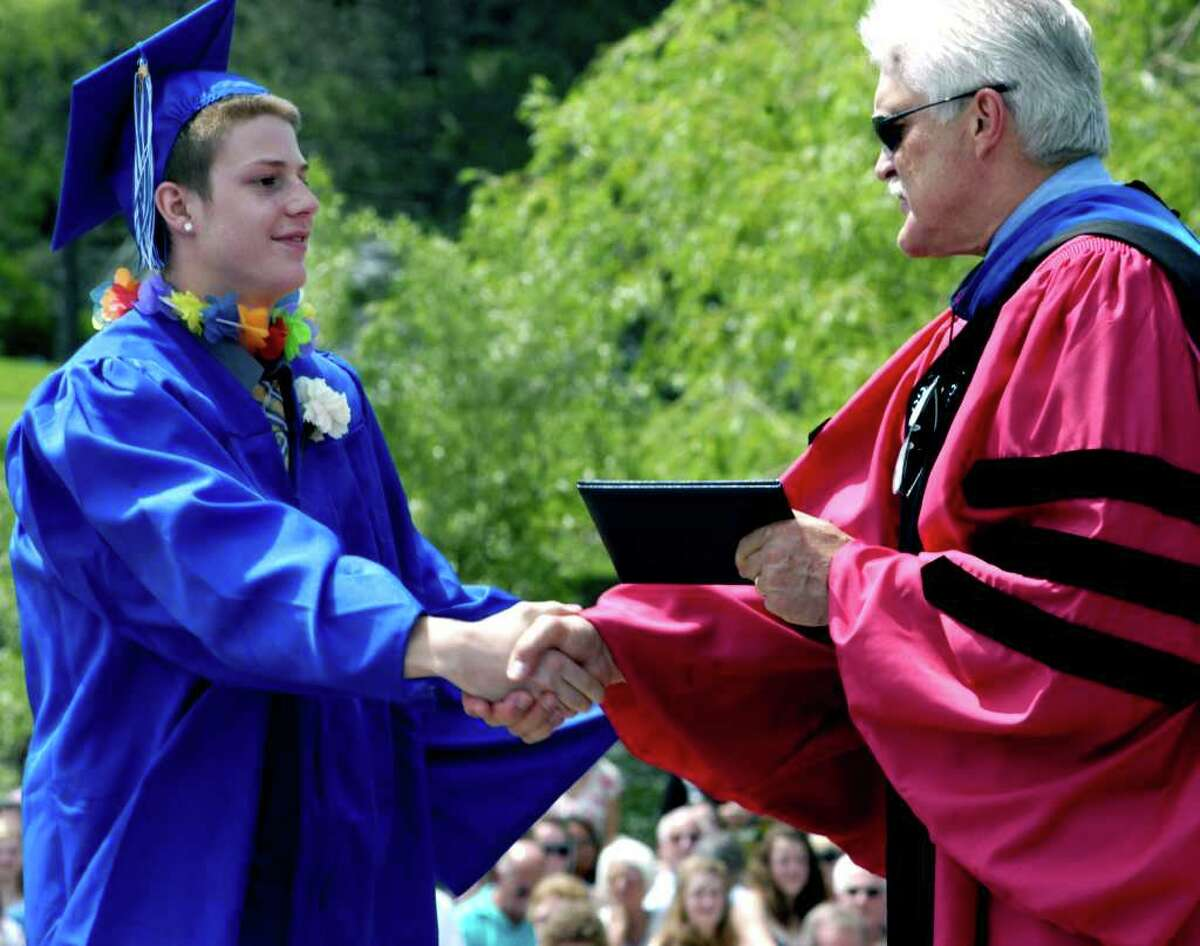 SPECTRUM/Nicholas Carlson is presented his diploma as a graduate of Shepaug Valley High School by Region 12 Superintendent of Schools Dr. Bruce Storm during commencement exercises held June 18, 2011 in front of a sun-drenched crowd on the school campus in Washington.