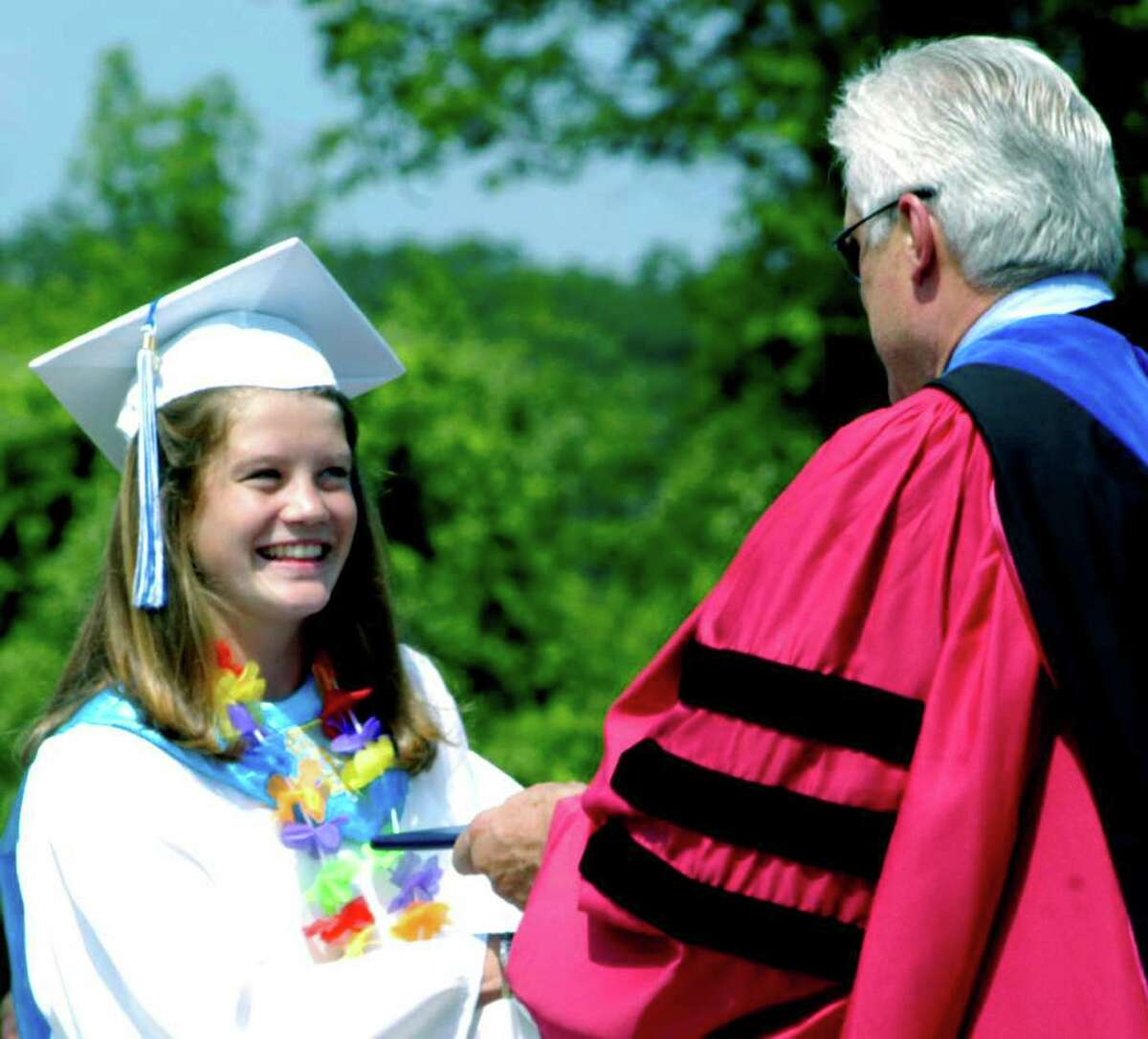 SPECTRUM/Linnea Quist is presented with her diploma as a graduate of Shepaug Valley High School by Region 12 Superintendent of Schools Dr. Bruce Storm during commencement exercises held June 18, 2011 in front of a sun-drenched crowd on the school campus in Washington.