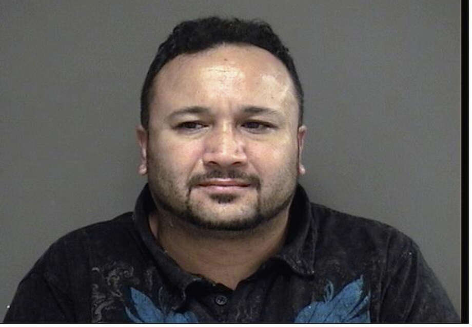 Ahmet Cilek was arrested Monday night after attempting to illegally obtain credit and debit card numbers and pin numbers from an ATM at Bank of America. Photo: Contributed Photo / Darien News