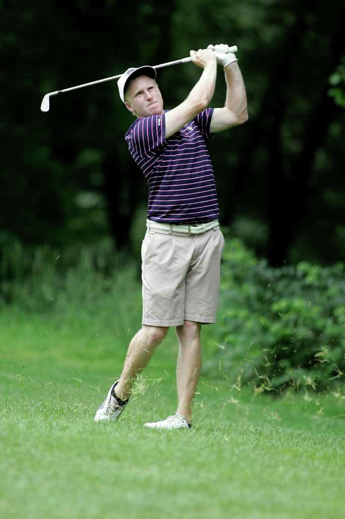 Tommy McDonaugh follows through with a small iron shot at the 109th CT Amateur golf championship at Rolling Hills CC in Wilton on Tuesday June 21, 2011.