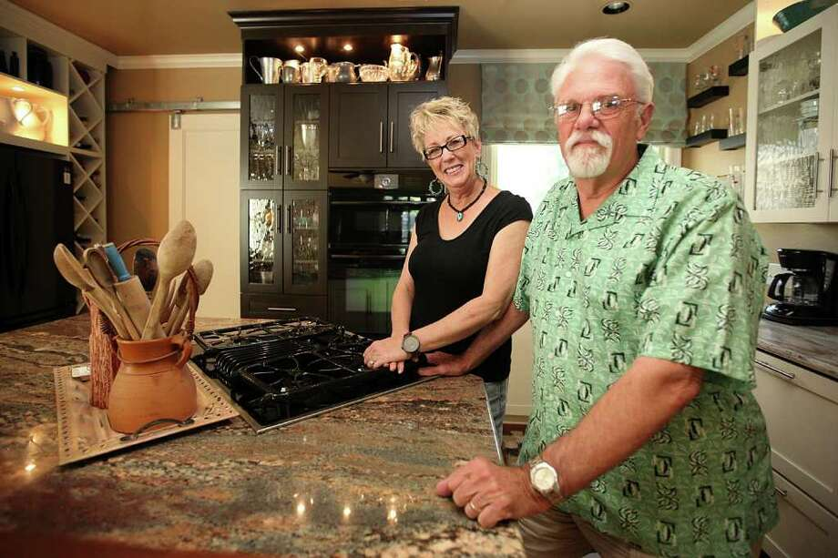 Lynda and Kenyon McDonald spent five months renovating the kitchen in their 1920s Olmos Park cottage. Photo: ANDREW BUCKLEY, SAN ANTONIO EXPRESS-NEWS / SAN ANTONIO EXPRESS-NEWS