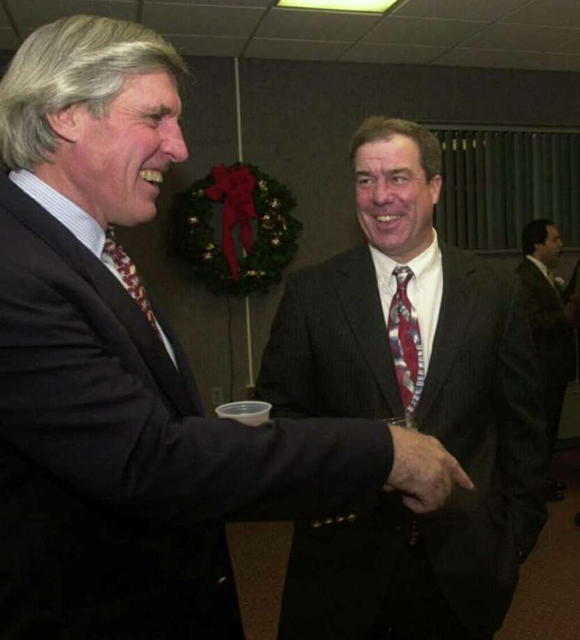 Bob Simms, left, a Greenwich resident and former New York Giants football player, talks with Jerry Courville, national honoree of the Stamford Old Timer's Athletic Association, in this December 2000 file photo. Photo: File Photo / Stamford Advocate File Photo