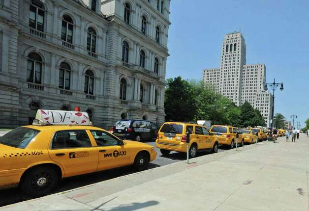 New York City yellow taxi cabs line the streets around the Capitol in Albany, N.Y. Tuesday June 21, 2011. Taxicab drivers descended on the Capitol on Tuesday to protest a bill that would expand ?street hail? rights and authorize the sale of 1,500 additional taxi medallions. (Lori Van Buren / Times Union) Photo: Lori Van Buren