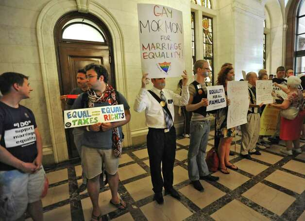 People who support and oppose same sex marriage line the hallways at the Capitol in Albany, N.Y. Tuesday  June 21, 2011.  (Lori Van Buren / Times Union) Photo: Lori Van Buren