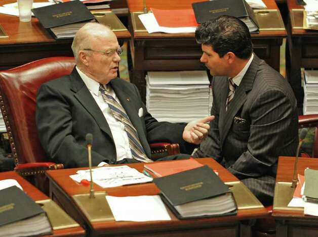 New York State Senator Hugh Farley talks with Assemblyman George Amedore in the Senate chamber at the Capitol in Albany, N.Y. Tuesday  June 21, 2011.  (Lori Van Buren / Times Union) Photo: Lori Van Buren