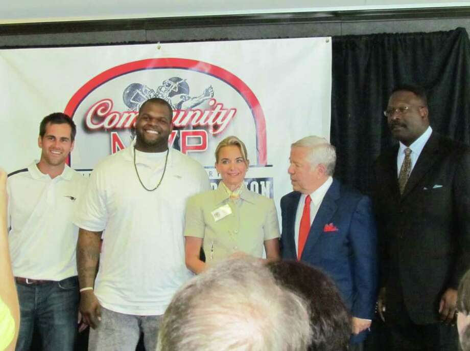 "Fairfield resident Katherine Sullivan, center, was recently honored as a ""Community MVP"" by the New England Patriots Charitable Foundation. To Sullivan's right are two members of the New England Patriots, Ron Brace and Stephen Gostkowski. To Sullivan's immediate left is Robert Kraft, president and CEO of the New England Patriots. Photo: Contributed Photo / Fairfield Citizen contributed"