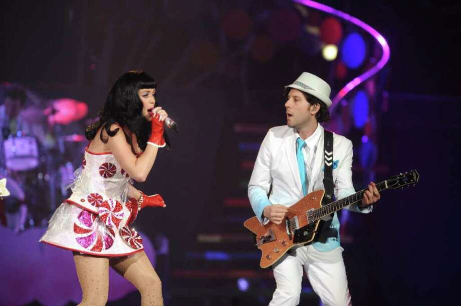 """Guitarist and Monroe native Patrick Matera performs with Katy Perry during the American leg of her """"California Dreams Tour 2011."""" The tour stops at the Mohegan Sun Arena on Saturday, June 25. Photo: Contributed Photo / Connecticut Post Contributed"""