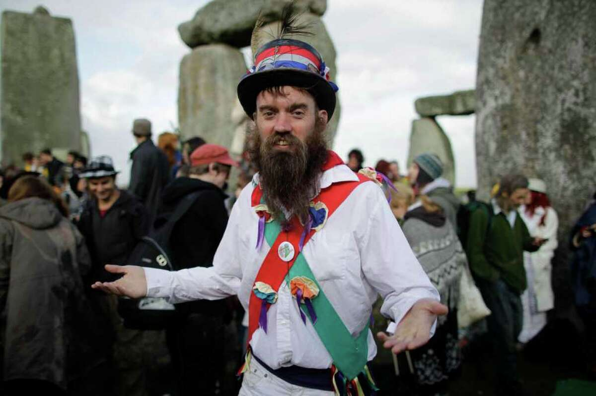 Morris Dancer Tom Clare, from the town of Brackley, in Northamptonshire, England, poses for a photograph during the Summer Solstice at Stonehenge on June 21, 2011. Clare said he morris danced from Avebury to attend the even and now plans to dance from Stonehenge to make it in time for the Glastonbury music festival, which opens on Wednesday. Morris dance is a traditional English form of folk dance.
