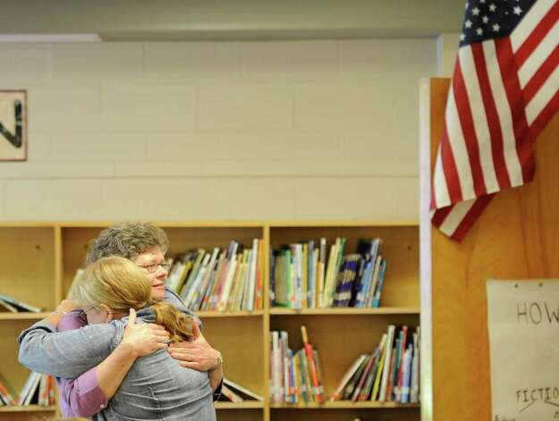 School nurse Kathy Betzhold, left, comforts art teacher Kathy Buckley on the last day of school at the Clarksville Elementary School in Clarksville, N.Y., on June 21, 2011.  The Clarksville Elementary School will close for good after this school year.  (Skip Dickstein/ Times Union) Photo: Skip Dickstein