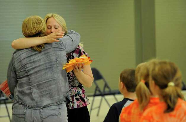 A teacher comforts art teacher Kathy Buckley, left,  on the last day of the school at the Clarksville Elementary School in Clarksville, N.Y. June 21, 2011.  The Clarksville Elementary School will close for good after this school year.  (Skip Dickstein/ Times Union) Photo: Skip Dickstein