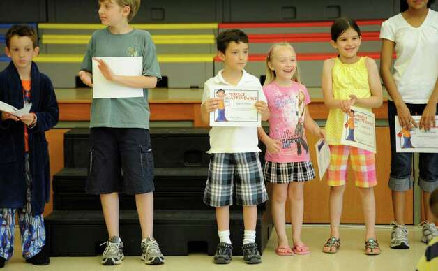 "Students line up for their ""perfect attendance"" certificates on the last day of  school at the Clarksville Elementary School in Clarksville, N.Y., on June 21, 2011.  The Clarksville Elementary School will close for good after this school year.  (Skip Dickstein/ Times Union) Photo: Skip Dickstein"