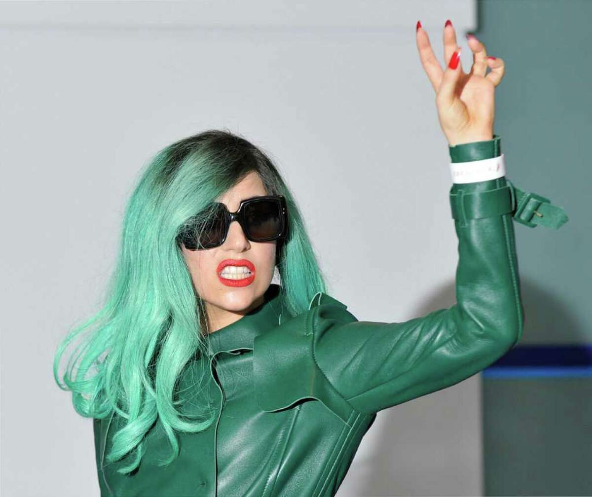 Entertainer Lady Gaga poses for the media upon her arrival at Narita Airport, Chiba prefecture. The singer is currently on an Asian tour to promote her new album.