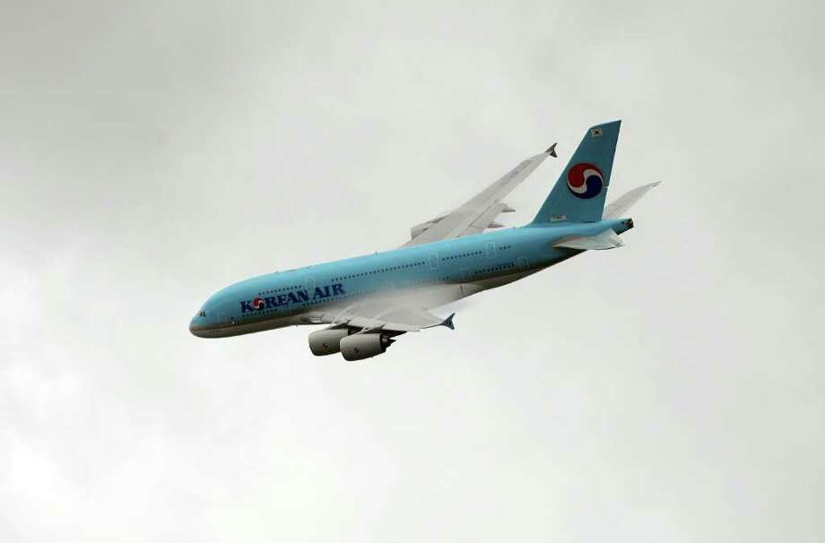 An Airbus SAS A380-800 airliner, operated by Korean Air Lines Co., makes a demonstration flight at the Paris Air Show in Paris, France, on Tuesday, June 21, 2011. Airbus SAS reached a goal of topping 500 orders for its upgraded A320neo aircraft by the end of the Paris Air Show on the second day of the event as carriers put pressure on Boeing Co. to respond with an all-new airliner. Photographer: Chris Ratcliffe/Bloomberg Photo: Chris Ratcliffe, Bloomberg / © 2011 Bloomberg Finance LP