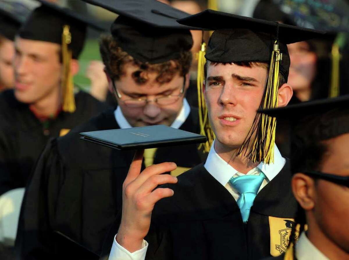 Conor Carty spins his diploma on the end of his finger, during Trumbull High School's Class of 2011 Commencement Exercises in Trumbull, Conn. on Tuesday June 22, 2011.