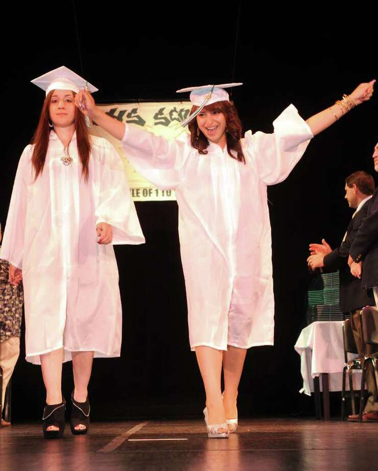 Students walk across the stage in the processional during Bassick High School's graduation ceremony at Klein Memorial Auditorium on Tuesday, June 21, 2011. Photo: Lindsay Niegelberg / Connecticut Post