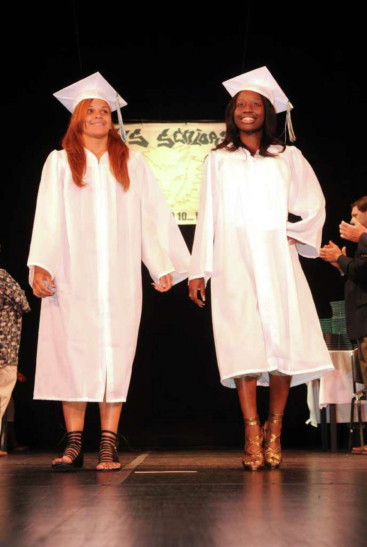 Students walk across the stage in the processional during Bassick High School's graduation ceremony at Klein Memorial Auditorium on Tuesday, June 21, 2011.