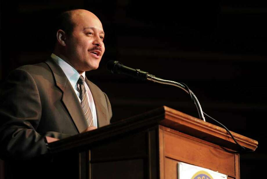 Principal Alejandro Ortiz speaks during Bassick High School's graduation ceremony at Klein Memorial Auditorium on Tuesday, June 21, 2011. Photo: Lindsay Niegelberg / Connecticut Post