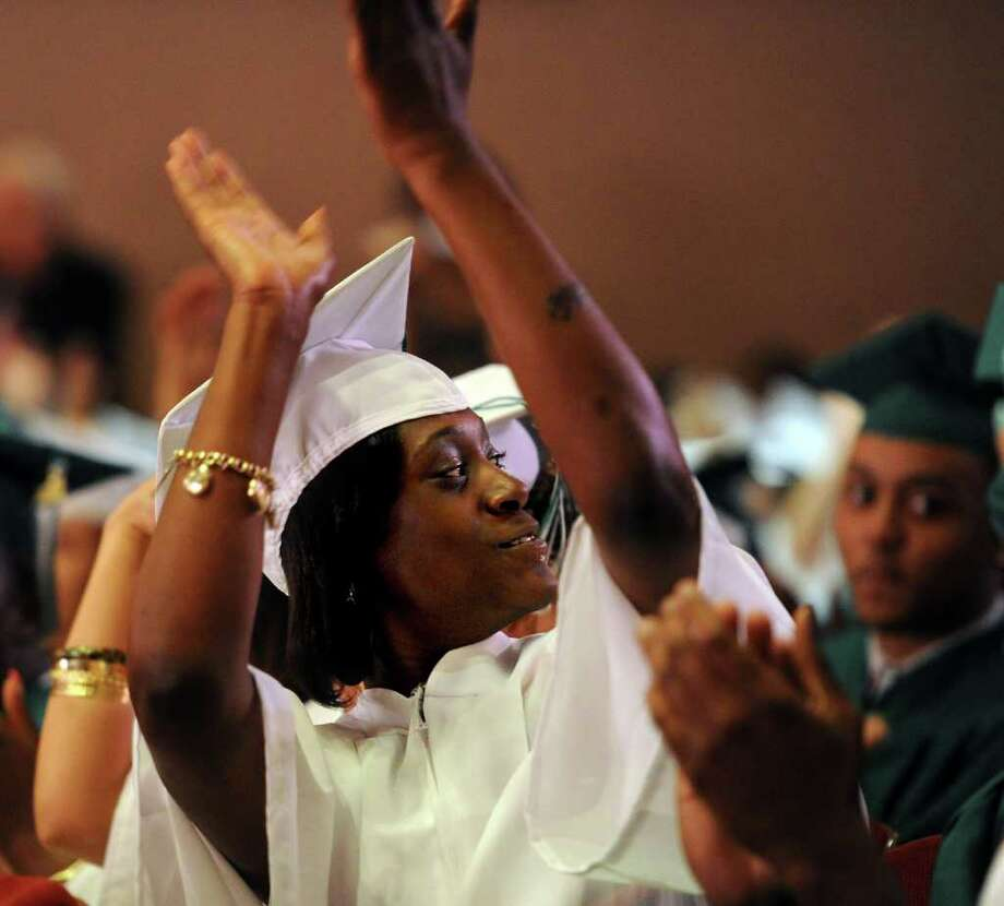 Vantajia Blackwell turns to clap for her friends and family during Bassick High School's graduation ceremony at Klein Memorial Auditorium on Tuesday, June 21, 2011. Photo: Lindsay Niegelberg / Connecticut Post