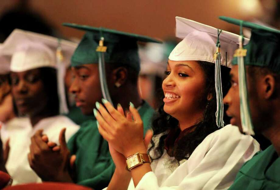 Kabrina Boyd claps during Bassick High School's graduation ceremony at Klein Memorial Auditorium on Tuesday, June 21, 2011. Photo: Lindsay Niegelberg / Connecticut Post