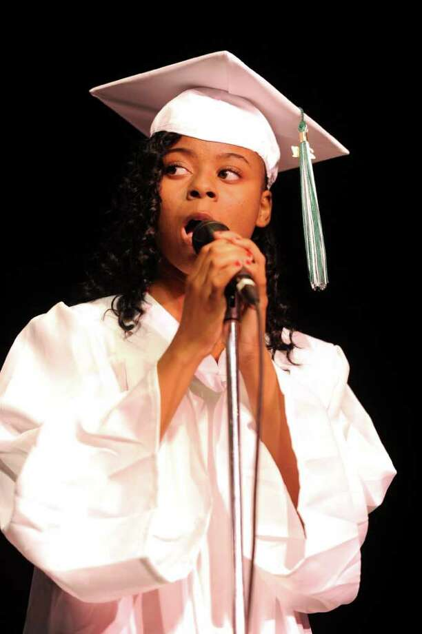 Iesha Anglin sings with a trio during Bassick High School's graduation ceremony at Klein Memorial Auditorium on Tuesday, June 21, 2011. Photo: Lindsay Niegelberg / Connecticut Post