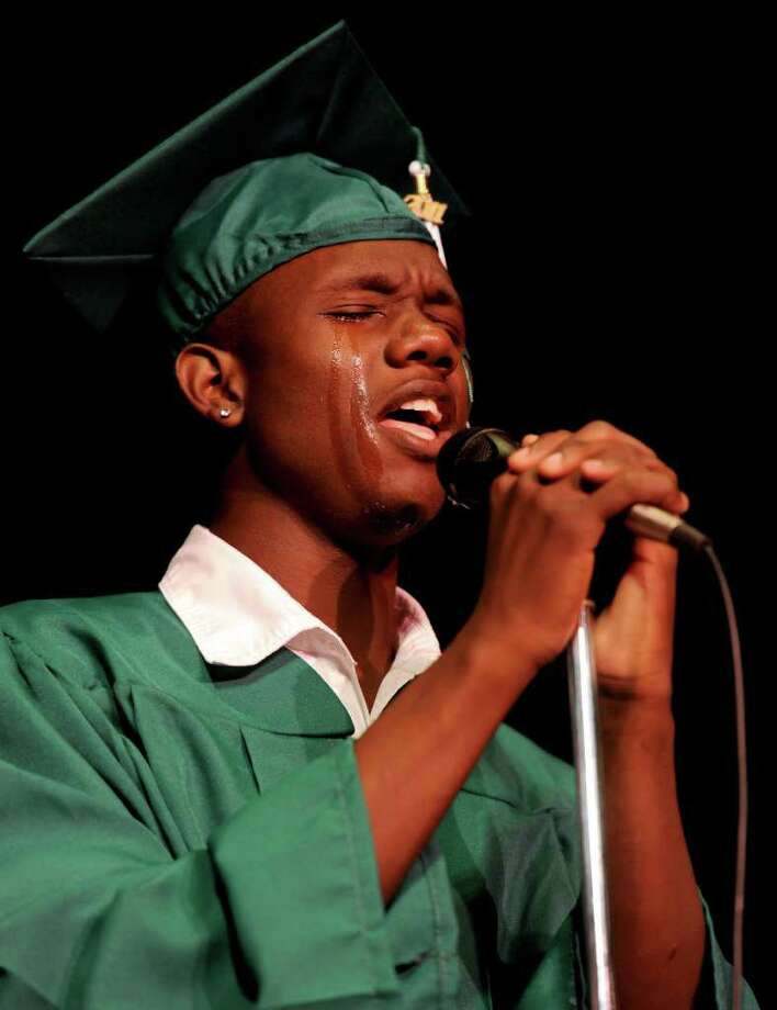 Tears roll down Reggie Carr's cheeks as he sings in a trio during Bassick High School's graduation ceremony at Klein Memorial Auditorium on Tuesday, June 21, 2011. Photo: Lindsay Niegelberg / Connecticut Post