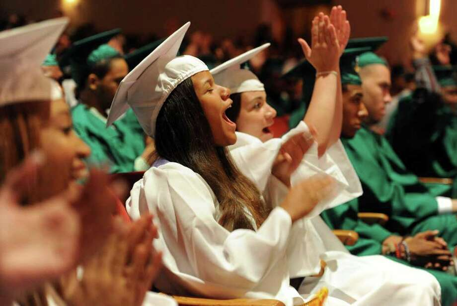 Krystle George celebrates with classmates during Bassick High School's graduation ceremony at Klein Memorial Auditorium on Tuesday, June 21, 2011. Photo: Lindsay Niegelberg / Connecticut Post