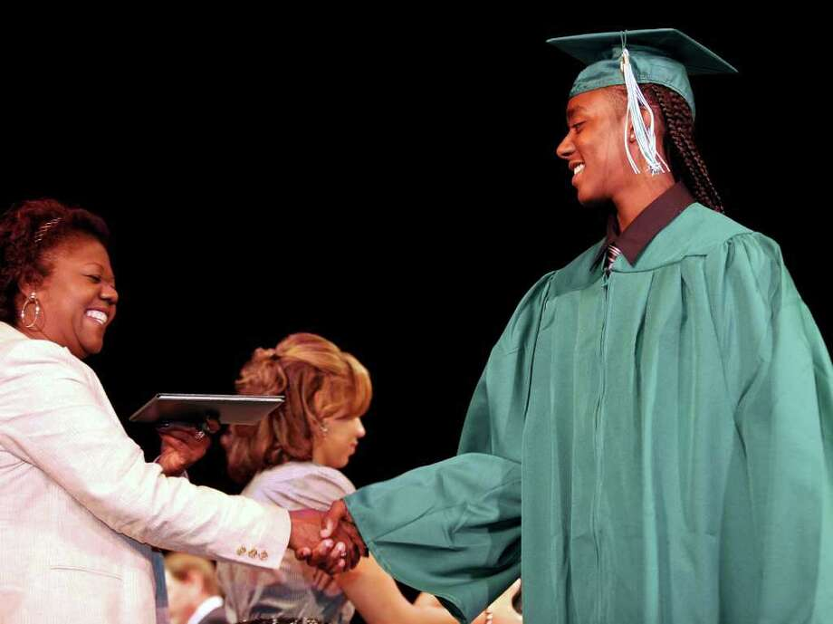 Ja'mill Powell gets his diploma during Bassick High School's graduation ceremony at Klein Memorial Auditorium on Tuesday, June 21, 2011. Photo: Lindsay Niegelberg / Connecticut Post