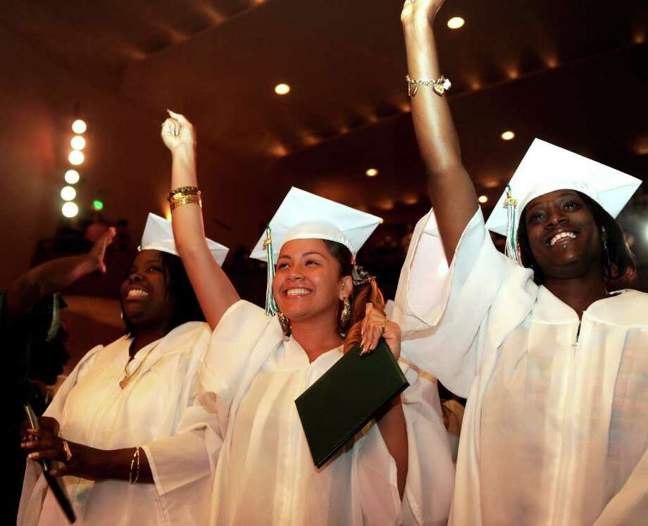 Students celebrate after completing Bassick High School's graduation ceremony at Klein Memorial Auditorium on Tuesday, June 21, 2011. Photo: Lindsay Niegelberg / Connecticut Post