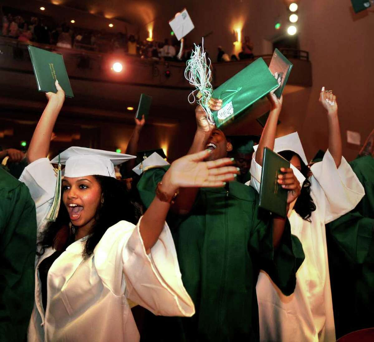 Students celebrate after completing Bassick High School's graduation ceremony at Klein Memorial Auditorium on Tuesday, June 21, 2011.