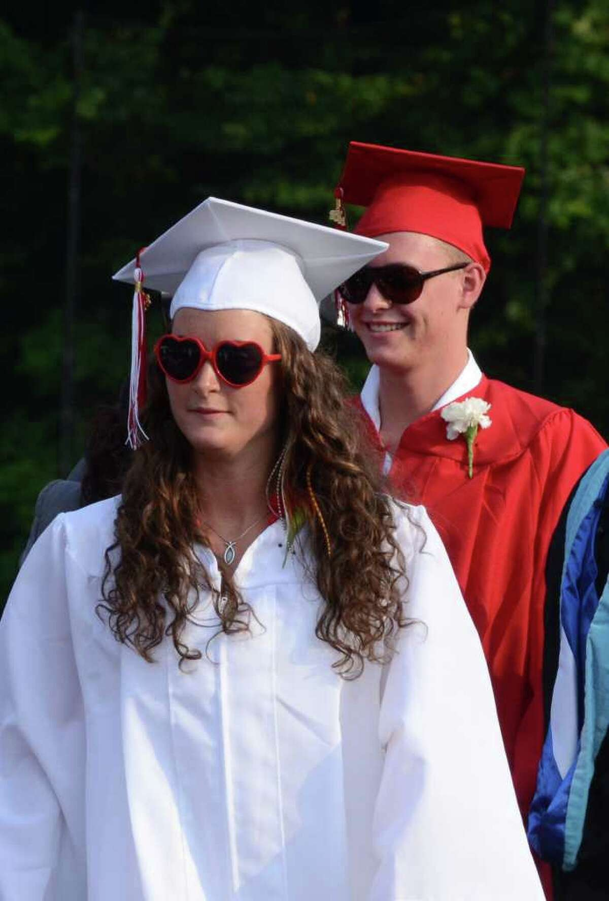 Alexandra Lloyd and Henry Lloyd sports sunglasses during the 2011 New Canaan High School Commencement on Tuesday, June 21, 2011.