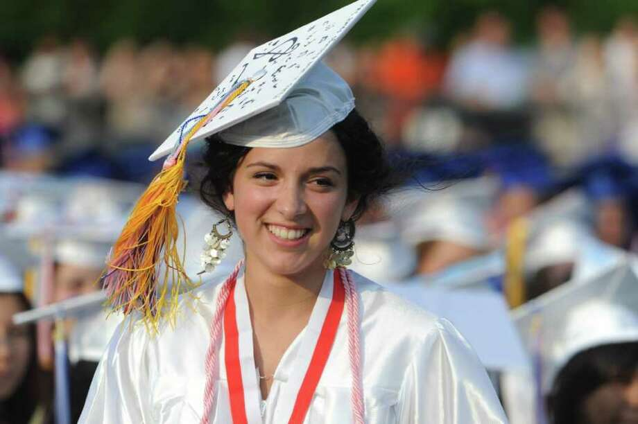 Class president Julia Gallagher heads for the podium to address classmates as Brien McMahon High School celebrates its fiftieth graduating class with commencement exercises in Norwalk, Conn., June 21, 2011. Photo: Keelin Daly / Stamford Advocate