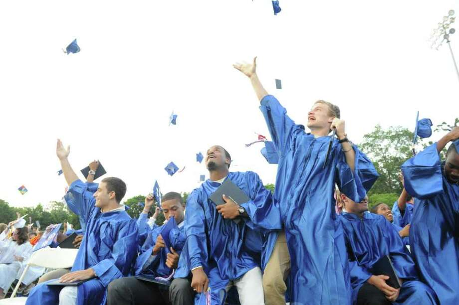 Graduates toss their hats at the conclusion of Brien McMahon High School's celebration of its fiftieth graduating class with commencement exercises in Norwalk, Conn., June 21, 2011. Photo: Keelin Daly / Stamford Advocate