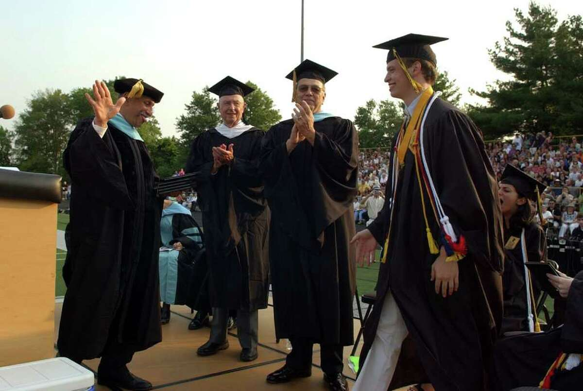 Highlights from Trumbull High School's Class of 2011 Commencement Exercises in Trumbull, Conn. on Tuesday June 22, 2011. Graduate Mark Maleri goes up for his diploma.