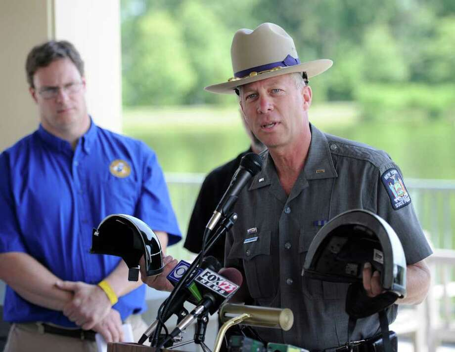 NYSP Lt. Jim Halvorsen speaks about the correct helmet to use while riding a motorcycle in New York at a press conference put on by the NYS Department of Motor Vehicles on motorcycle safety held in Colonie, N.Y. June 21, 2011.   (Skip Dickstein/ Times Union) Photo: Skip Dickstein