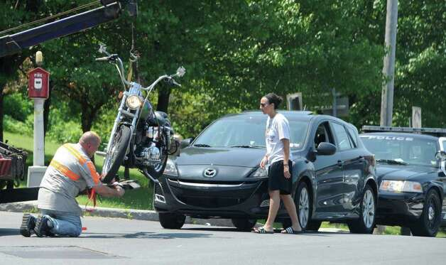 A motorcycle is hung from a tow truck after a personal injury accident at the intersection of Crane Street and Broadway in Schenectady on same day of a press conference on motorcycle safety put on by the NYS Department of Motor in Colonie, N.Y. June 21, 2011.   (Skip Dickstein/ Times Union) Photo: Skip Dickstein