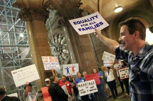 Protestors from opposing sides of the same-sex marriage debate demonstrate in the hallways of the capitol building, Albany during a rally in support of same-sex marriage on Tuesday, June 21, 2011.  (Erin Colligan / Special To The Times Union)