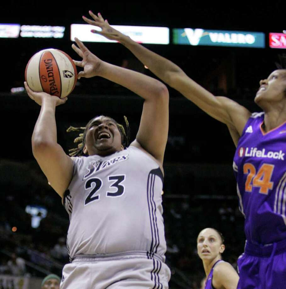 The Silver Stars' Danielle Adams (23) attempts a shot against the Mercury's Dewanna Bonner (24) during the Silver Stars' 105-98 loss to Phoenix at the AT&T Center on Tuesday, June 21, 2011. Photo: Sally Finneran/sfinneran@express-news.net / sfinneran@express-news.net