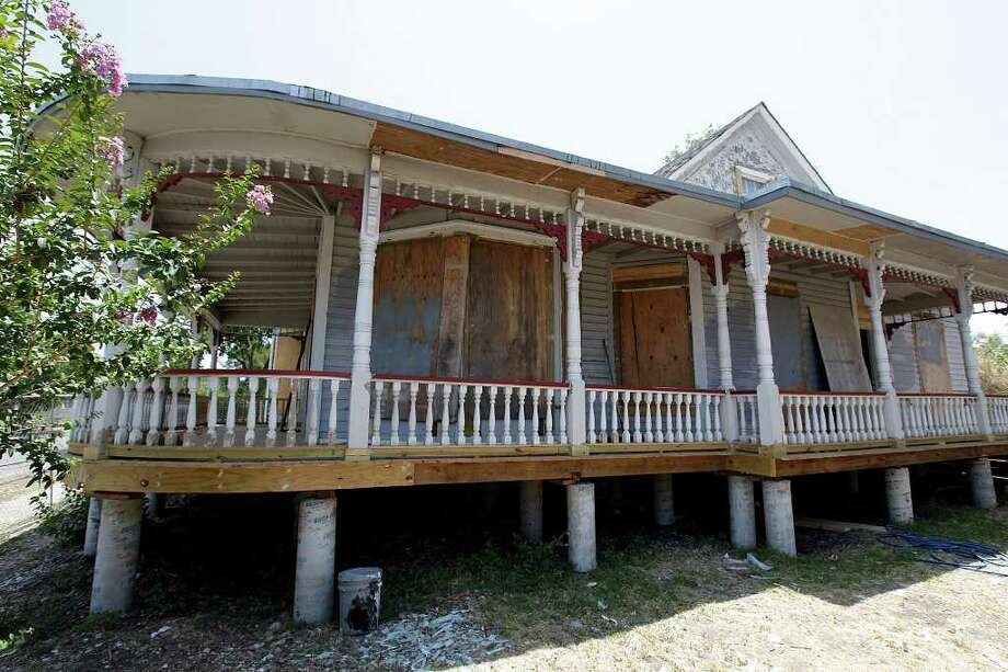 Construction starts at Carol Burnett childhood house in West San Antonio, Monday, June 20, 2011. The Victorian house was threaten with demolition when former Secretary of HUD and San Antonio Mayor Henry Cisneros bought the house and moved it to its present location at the 2000 block of West Commerce. It is being converted to a learning center for children. JERRY LARA/glara@express-news.net Photo: JERRY LARA, Express-News / SAN ANTONIO EXPRESS-NEWS