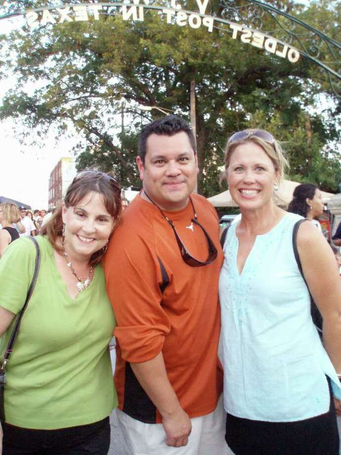 Theresa Willis (from left) Joseph Gonzales and Karen Kirby enter the gate at the Twisted Taco Truck Throwdown af VFW Post 76 on the Museum Reach.
