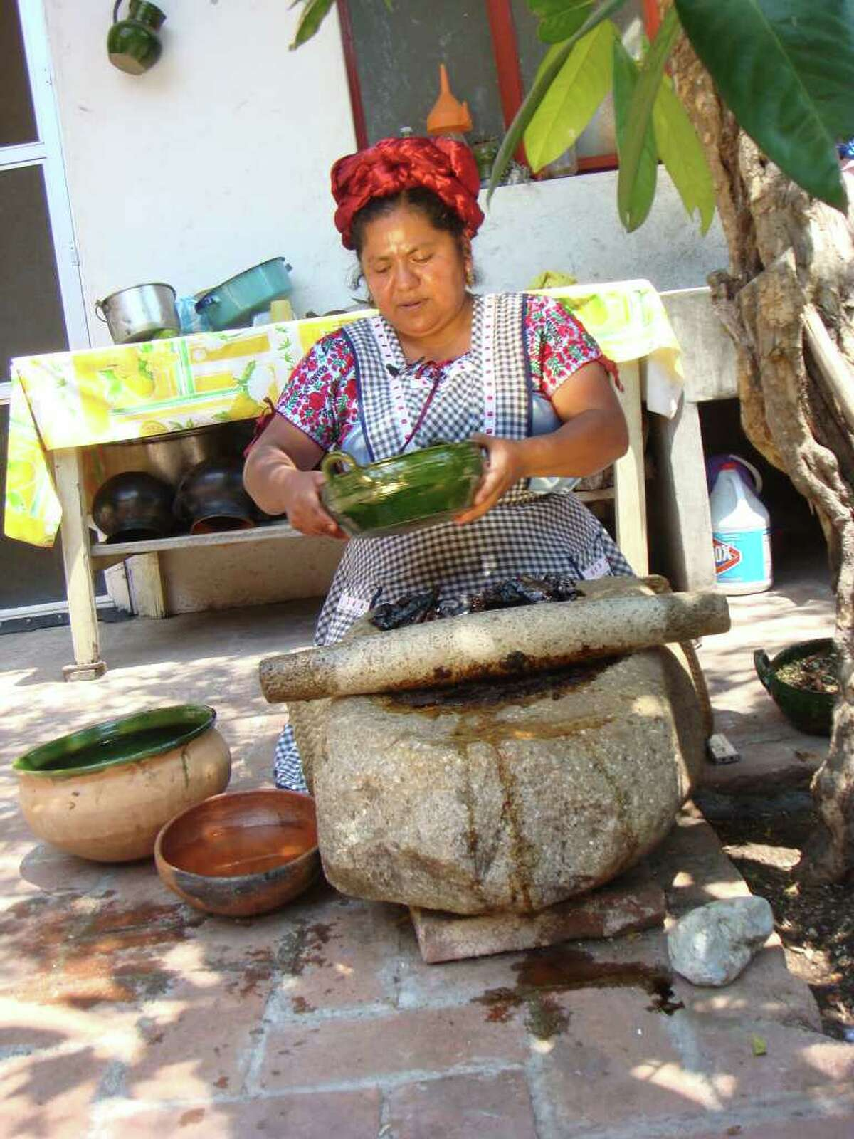 Dish: Mole. In this photo Abigail Mendoza prepares mole in Oaxaca, Mexico. Traveling Latin America in search of the culinary past and present.