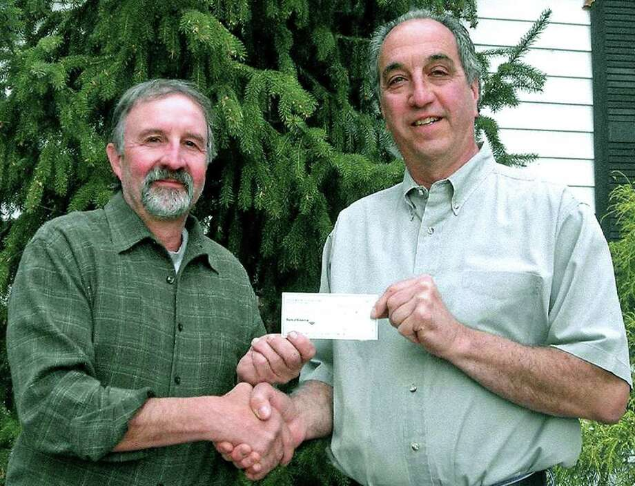 Community generosity  SPECTRUM/The Helen Knowles Harcourt Foundation and the John Pettibone Memorial Scholarship Fund again this year have been a major donor to college scholarships given to New Milford High School graduates. Above, Bob Nicholas, left, the foundation president, presents a $25,000 check to Bob Marandola, the chairman of the Pettibone fund committee. The Pettibone fund gave $67,000 in all to 30 NMHS seniors this year, including the first $5,000 of a possible $20,000 to Class of 2011 member Cody Smith. The Pettibone scholarships are named for John Pettibone, a teacher, NMHS principal and superintendent of schools in the New Milford for more than four decades during the first half of the 20th century. Photo: Contributed Photo / The News-Times Contributed