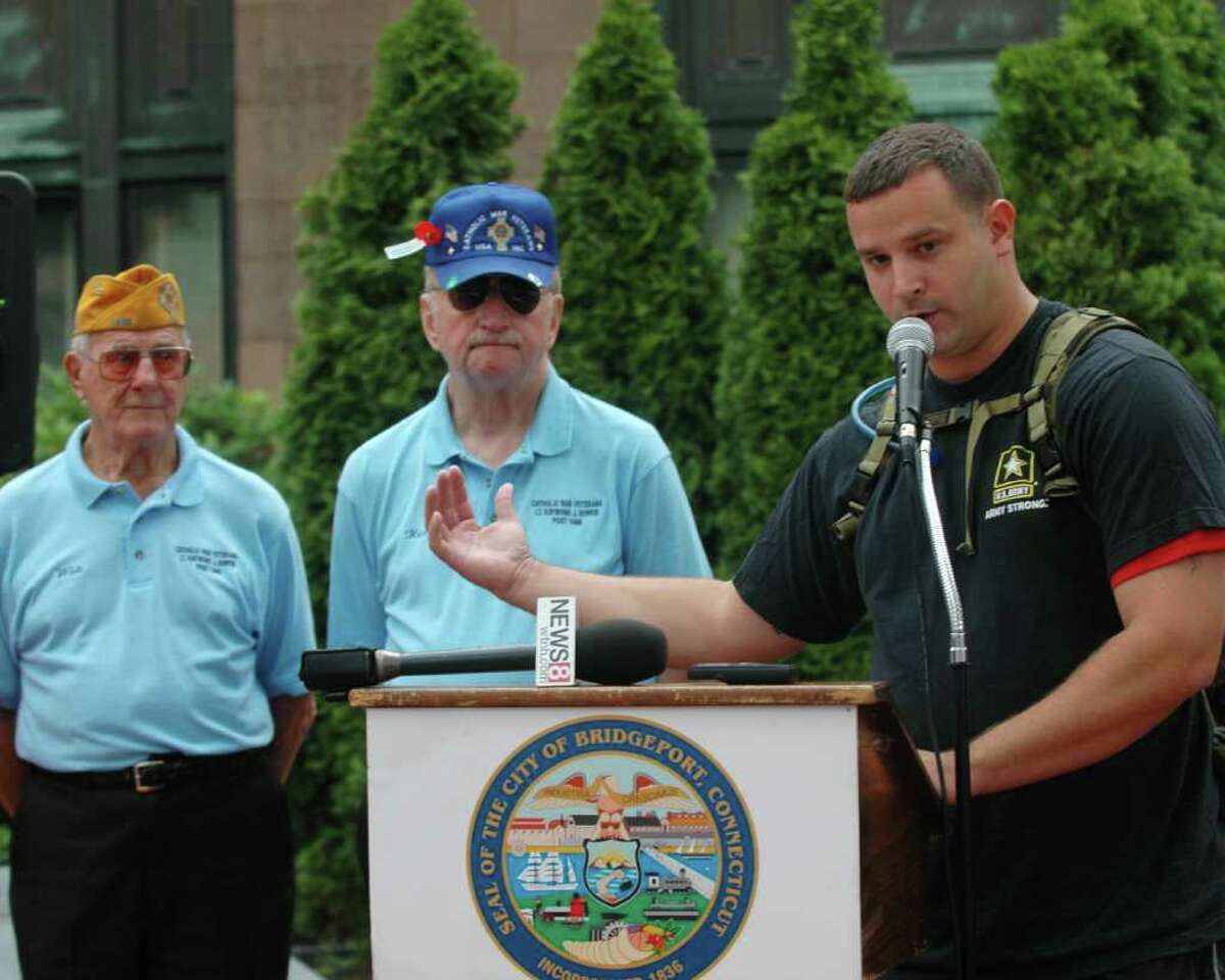 Troy Yocum, an Iraq War veteran, thanked other veterans like Walt Stachacz and Ken Jones at the War Memorials in Bridgeport, Conn. on Wednesday June 22, 2011. Yocum is in the midst of a 7,000 mile hike across the country to raise $5 million for military families.