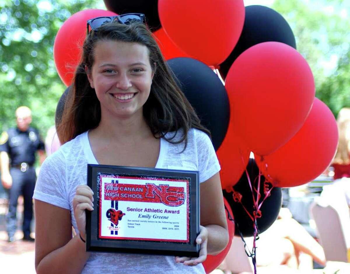 Emily Greene holds up her Senior Athletic award during the Student Athlete Awards ceremony at Waveny House, Monday, June 21, 2011.