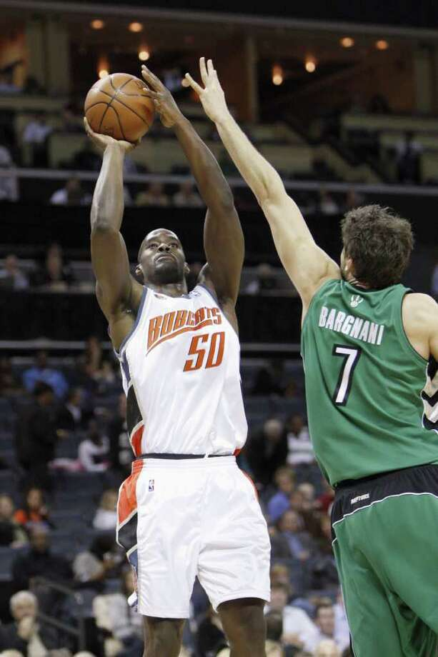 EMEKA OKAFOR was drafted second overall by the expansion Charlotte Bobcats and won the 2005 NBA Rookie of the Year award. He wound up playing five seasons and for the Bobcats, averaging a double double in points and rebounds while battling weight and injury problems. In 2007 he beame the first player to make 10 blocks at Madison Square Garden in a game vs. the New York Knicks. (Photo by: Streeter Lecka/Getty Images) Photo: Getty Images