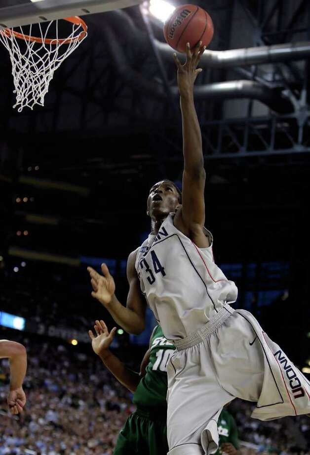 HASHEEM THABEET started playing basketball at age 15 in Tanzania. Because of his blocking prowess, the 7-foot-3 presence was a Big East Defensive Player of the year twice and the Big East Co-Player of the Year as a junior in 2009. He averaged 13.6 points and 10.8 rebounds as UConn reached the 2009 Final Four. He declared for the NBA Draft and was taken No. 2 overall by the Memphis Grizzlies. (Photo by Andy Lyons/Getty Images) Photo: Getty Images