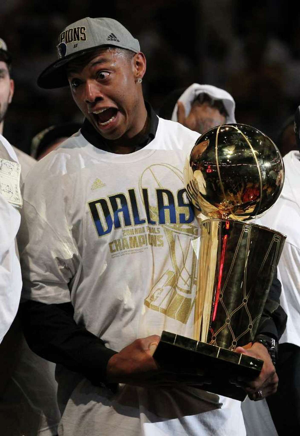 Despite missing the series due to a season-ending knee injury in January, Caron Butler earned his first NBA championship ring with the Dallas Mavericks. Above, he celebrates with the Larry O'Brien trophy after the Mavericks won 105-95 against the Miami Heat in Game Six of the 2011 NBA Finals at American Airlines Arena on June 12, 2011 in Miami, Florida. (Photo by Ronald Martinez/Getty Images)
