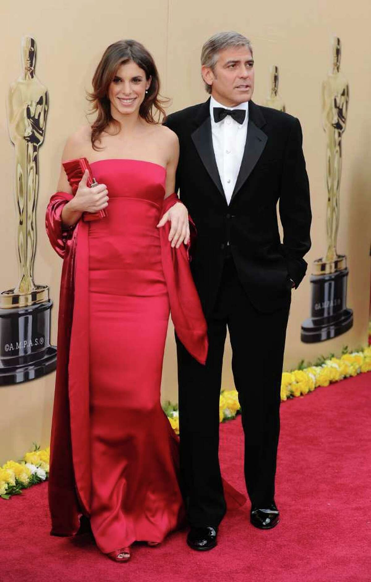 Actor George Clooney and Italian model Elisabetta Canalis issued a joint statement Wednesday confirming that they have broken up. That means one of the world's hottest leading men is available again, although he has said he will never marry again or have kids. Here, Clooney and Canalis arrive at the 82nd Annual Academy Awards on March 7, 2010 in Hollywood, California.